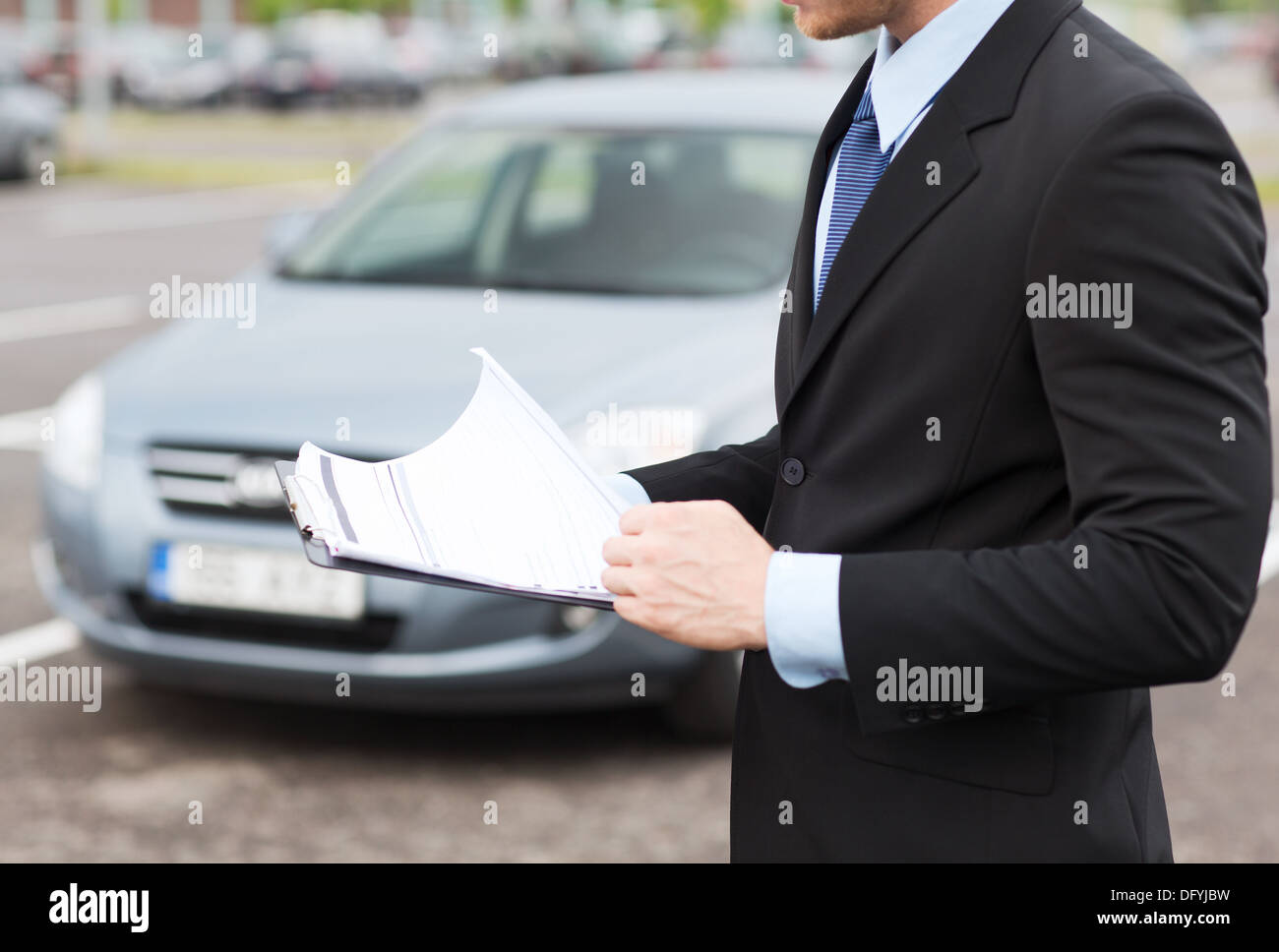 Man With Car Documents Outside - Stock Image