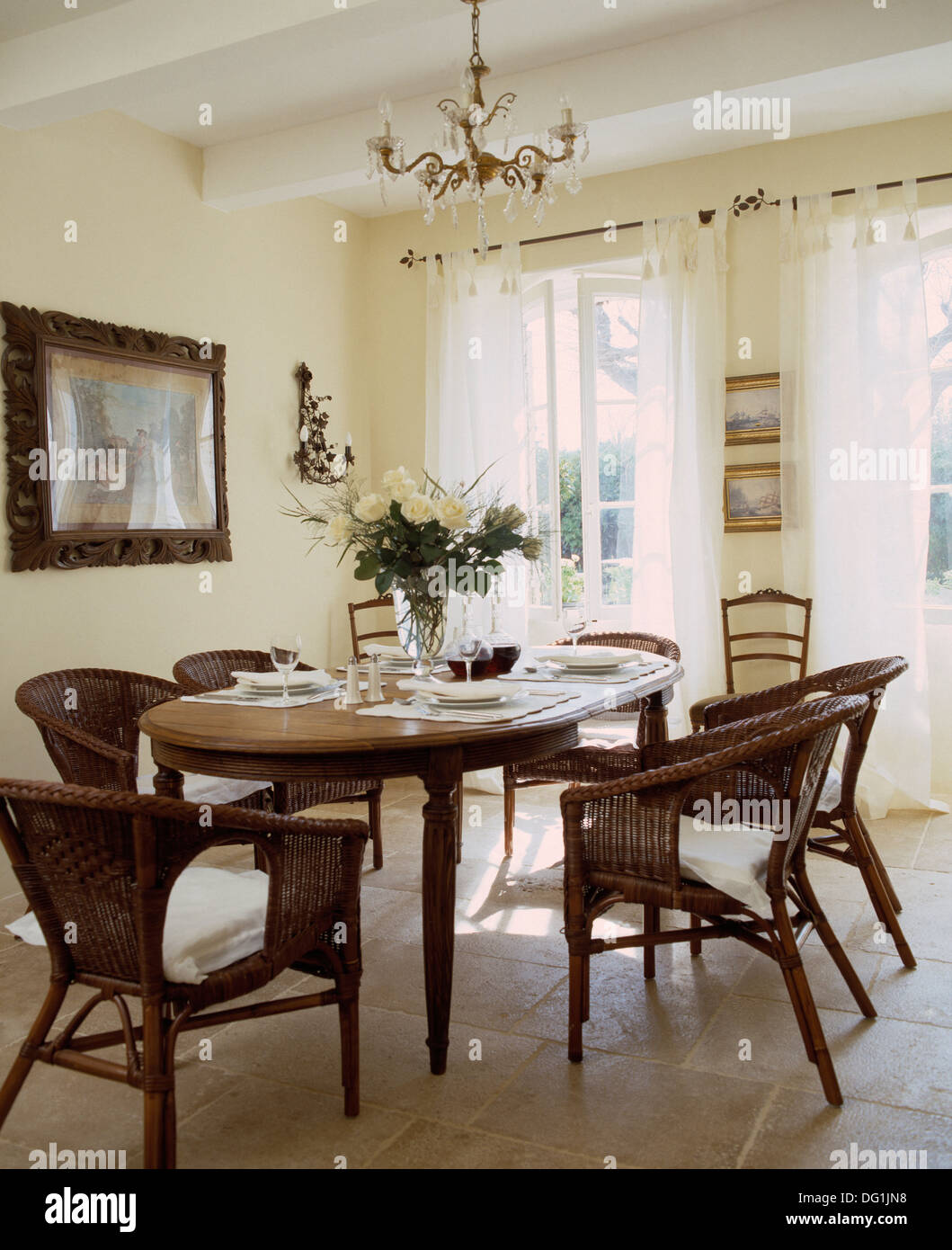 white wicker chairs and table wheelchair zombie at oval antique set for lunch in country dining room with voile drapes stone tiled floor
