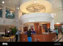 Reception Desk Hotel Guests Stock &