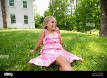 Young Girl In Pink Patterned Sundress Sitting