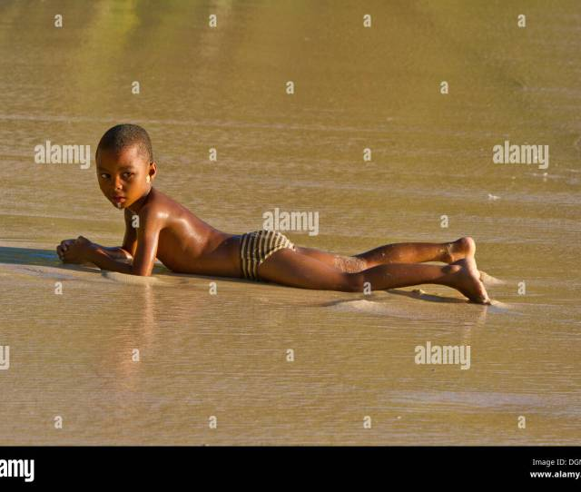 Creole Boy Lying On A Beach Mahe Island Seychelles Africa Indian Ocean