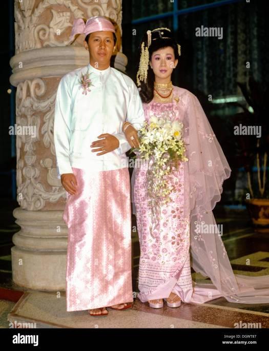 Married couple wearing traditional costume, wedding ...