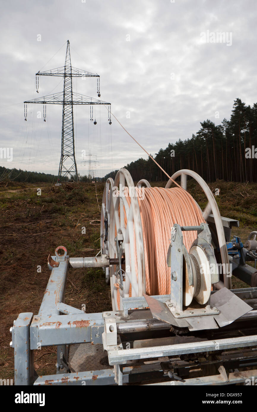 hight resolution of lineman working with a wire rope hoist on a 380 kv long distance line
