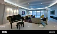 Grand piano in large modern apartment living room with ...