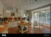 Butcher's block in country-style Spanish kitchen with ...