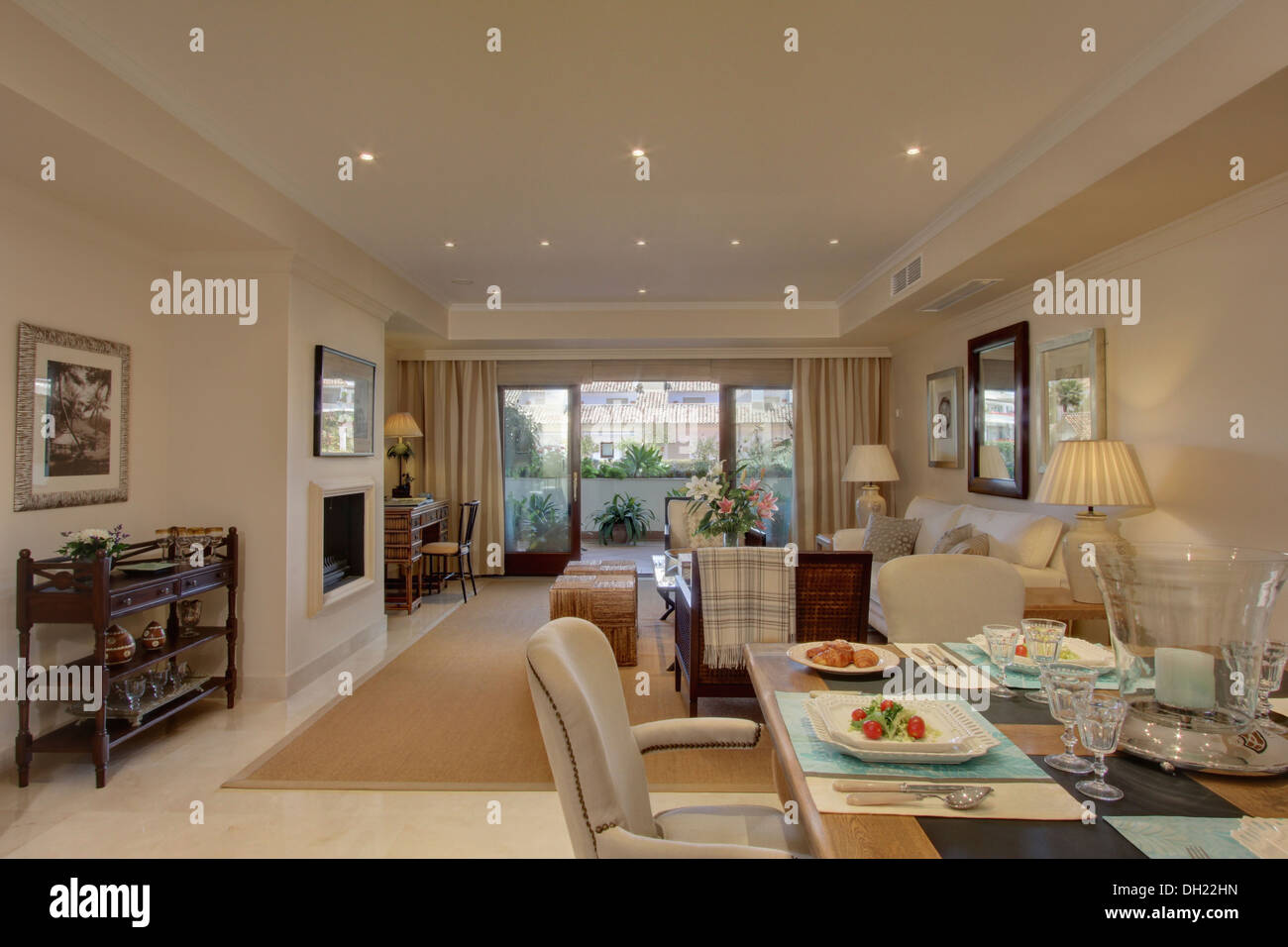 glass table sets for living room paint colors with cathedral ceilings set lunch in dining area of open plan modern spanish apartment doors to the balcony