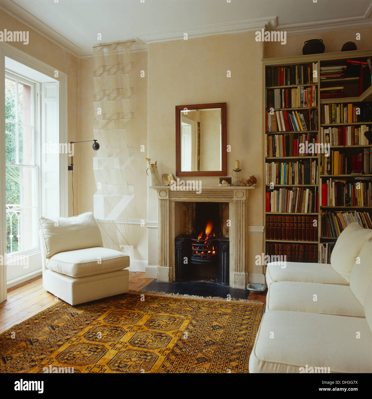 yellow chairs for living room small log burner white chair and sofa in with patterned oriental rug front of georgian fireplace lighted fire
