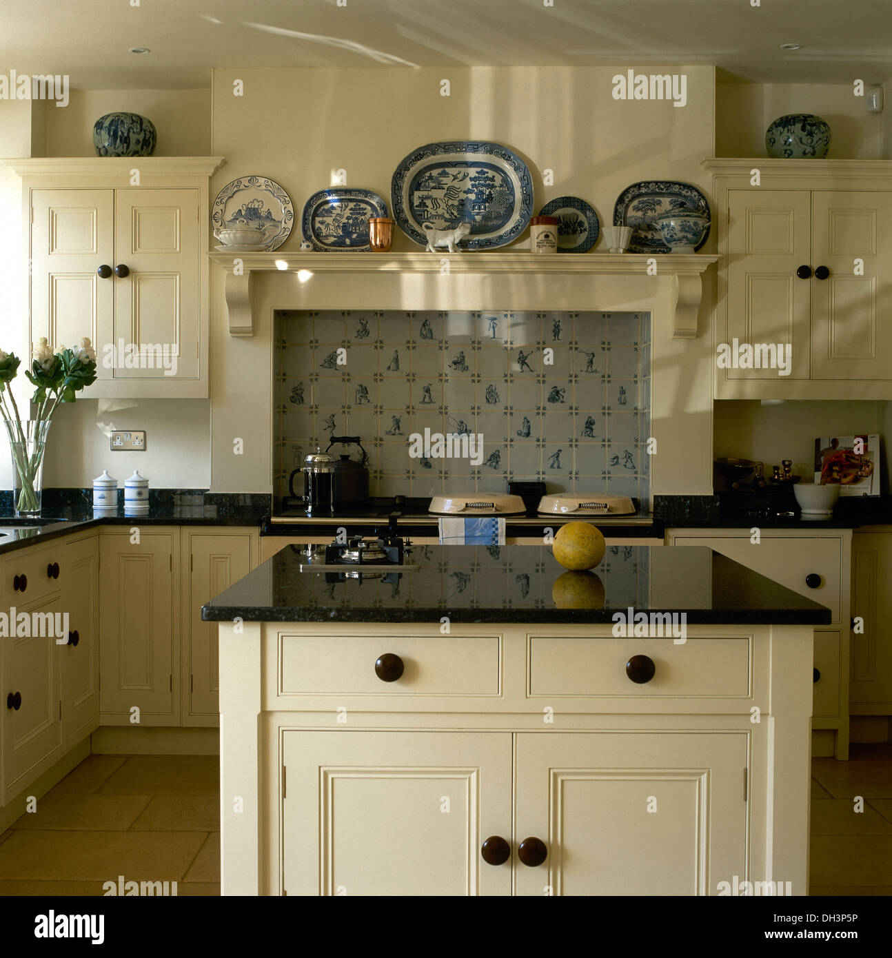 Granite Worktop On Island Unit In Country Kitchen With
