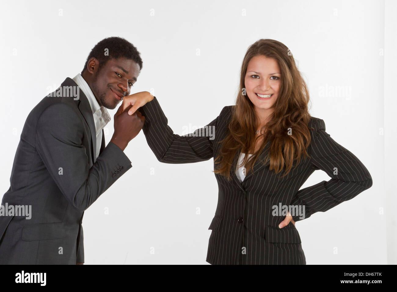 man kisses woman hand