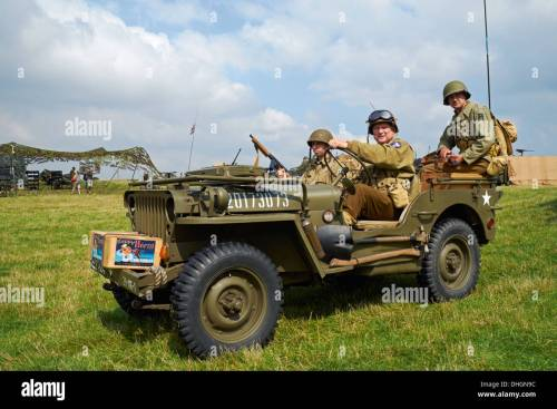 small resolution of men posing in ww2 us army uniforms in a 1943 willys mb jeep rauceby war
