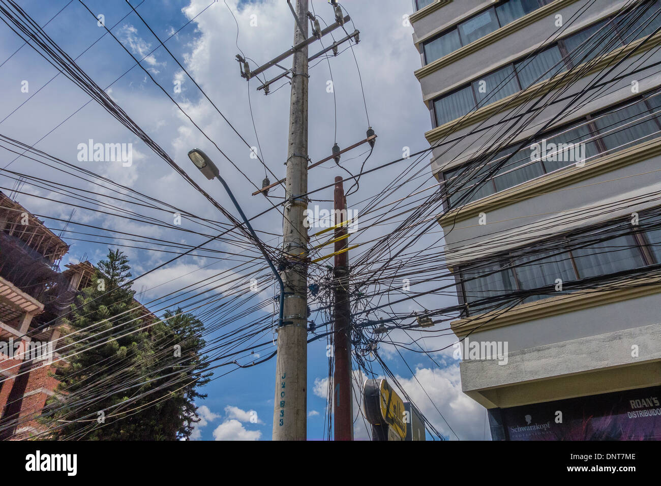 hight resolution of tangled electrical and telephone wiring in bolivia causing a real complex mess for technicians working on the lines