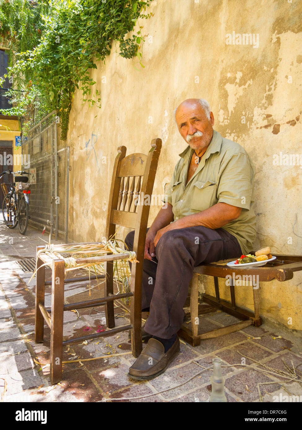 fixing wooden chairs chair cover hire peterborough maker a in the streets of chania crete island greece