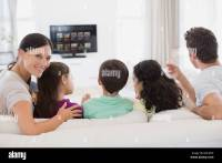 Family watching TV in living room Stock Photo: 66047506 ...