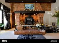 Fantastic brick fireplace with wood burning stove Stock ...