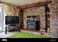 Brick fireplace with wood burning stove and flatscreen ...