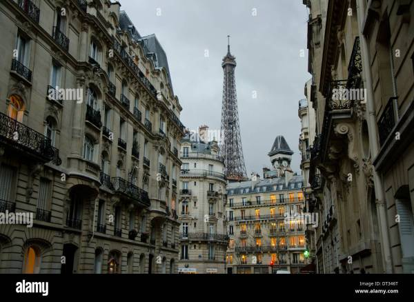 Parisian Buildings In Evening Street With Eiffel Tower Stock Royalty Free