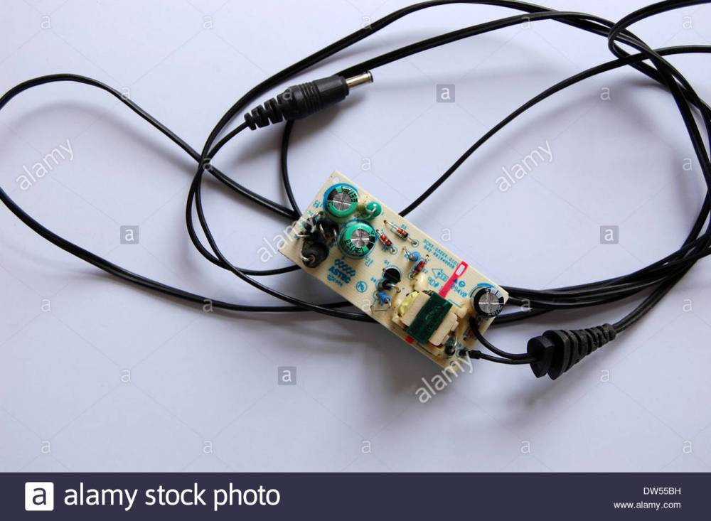 medium resolution of closeup studio shot cell phone telephone cellphone battery charger with cover removed to show electronic circuits inside