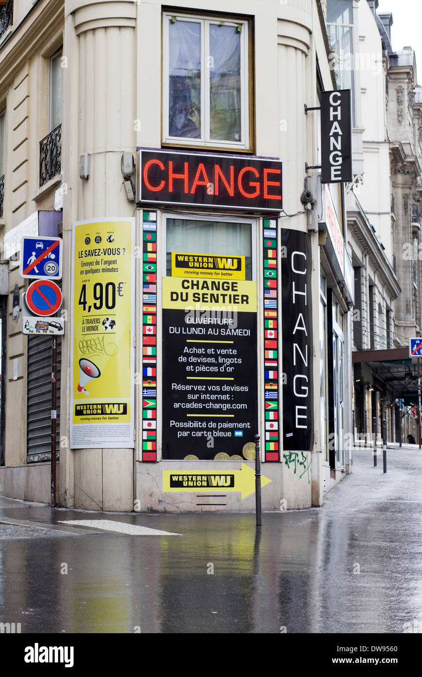 bureau de change exchange currency on the streets of paris france in the rain stock