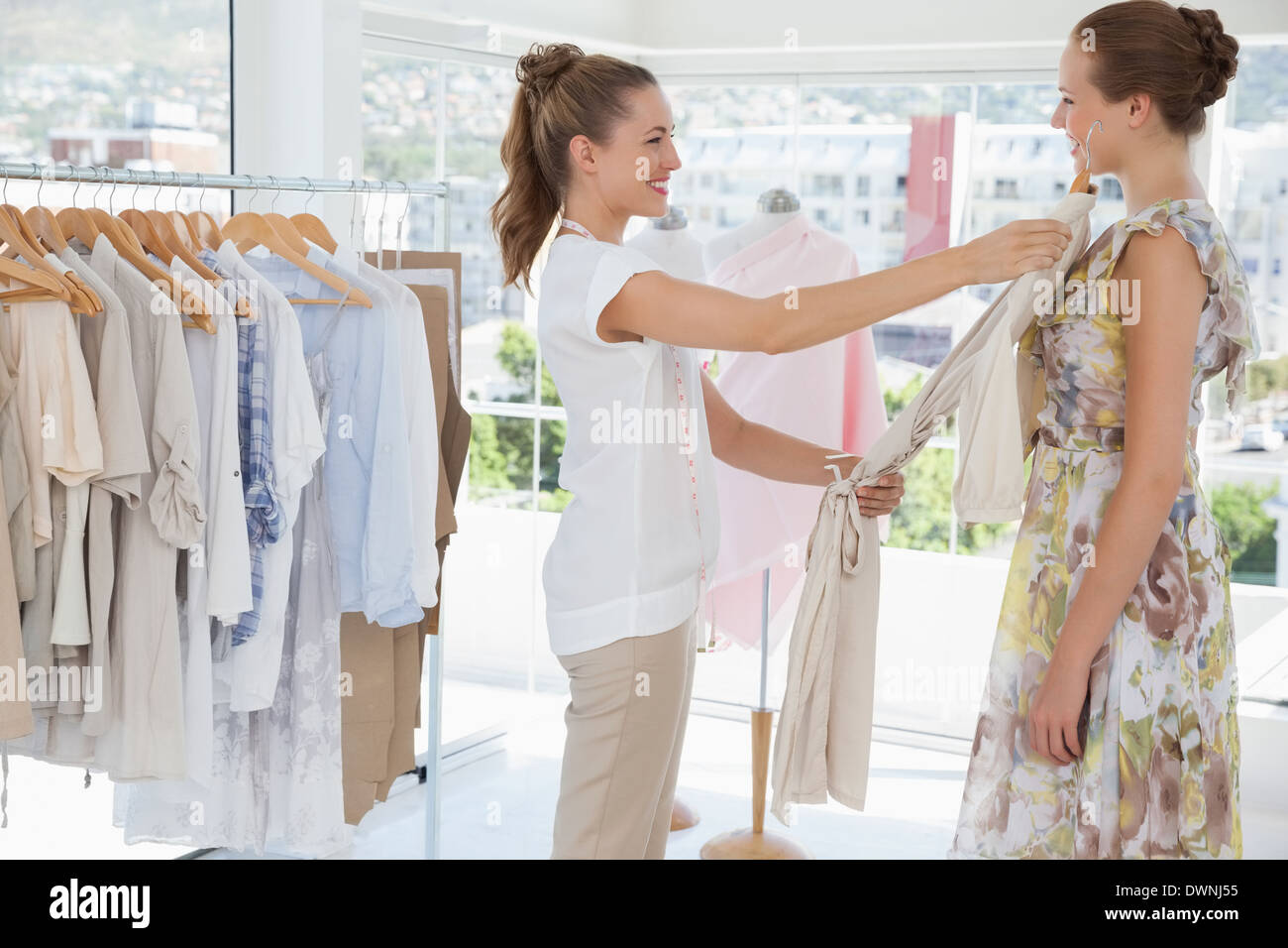 saleswoman assisting woman with