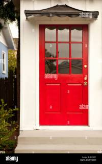 Red front door with black pagoda awning Stock Photo ...