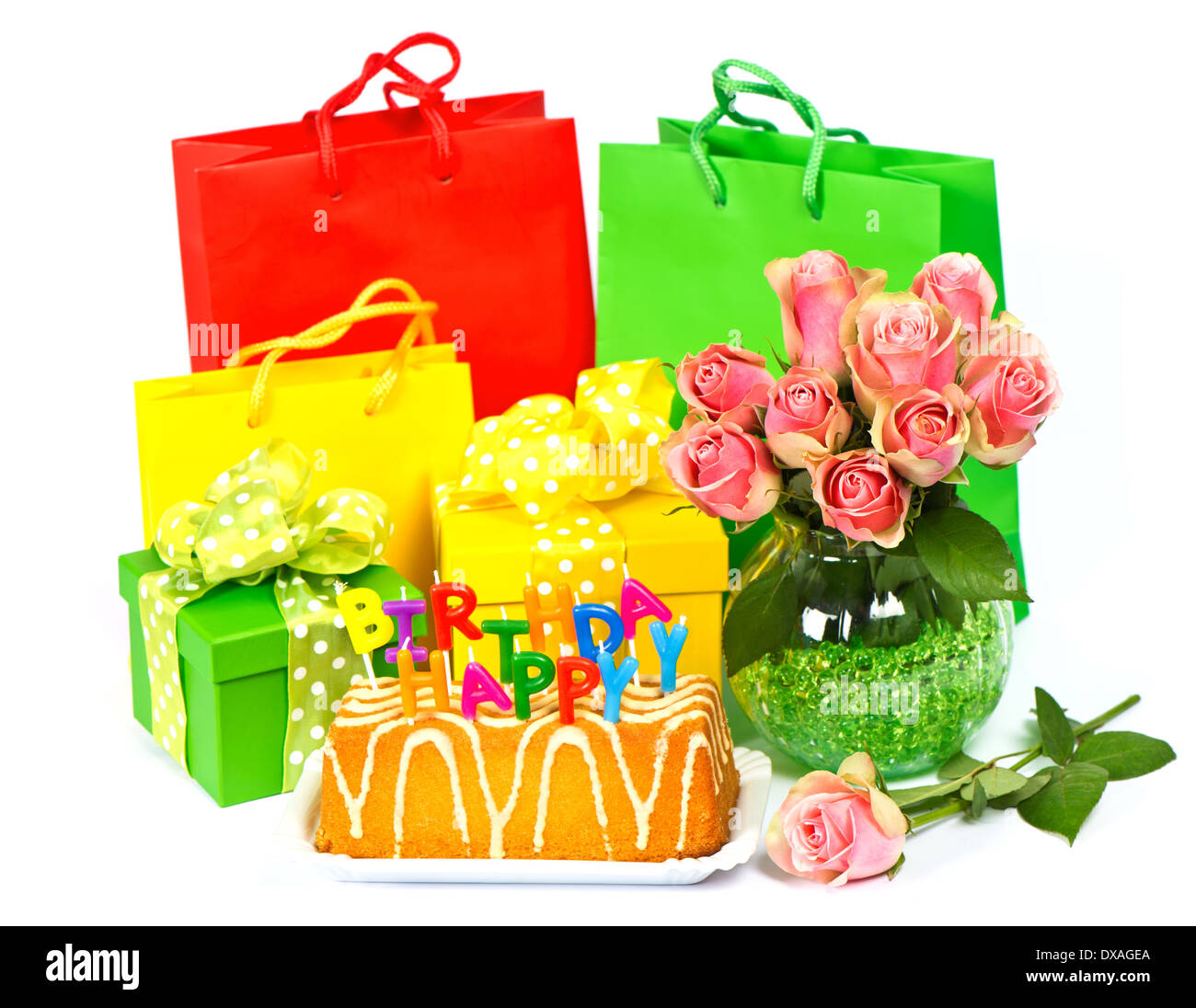 Happy Birthday Cake With Candles Flowers And Gift Stock Photo