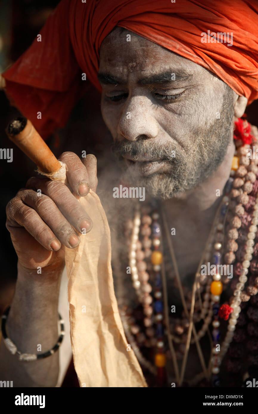 India, Uttar Pradesh, Varanasi, portrait of Sadhu smoking