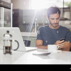 Kitchen Phone Rugs And Mats Man Texting With Cell At Table Stock Photo 68143696