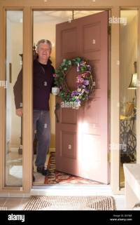 Mature Man Opening Front Door of Residential Home, FL,USA ...