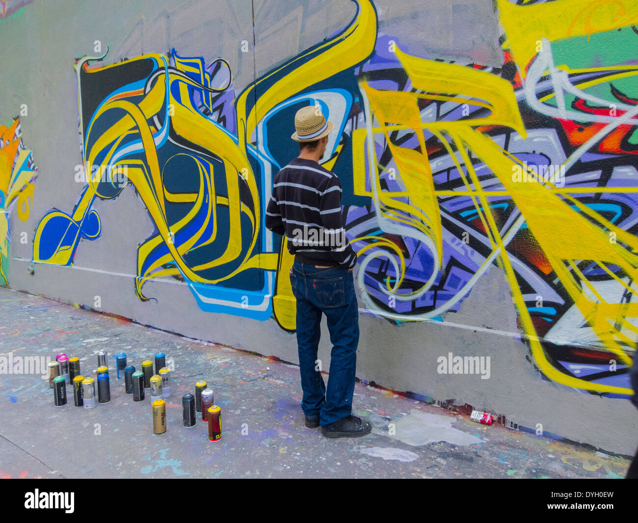 paris, france, young french teen, graffiti artist, painting wall on