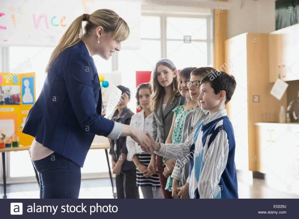 Elementary Teacher Handshaking With Students Science