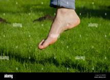 Bare Foot Walking Grass Stock &