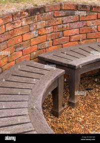 Curved Wooden Bench Seat And Old Red Brick Wall, Coton ...