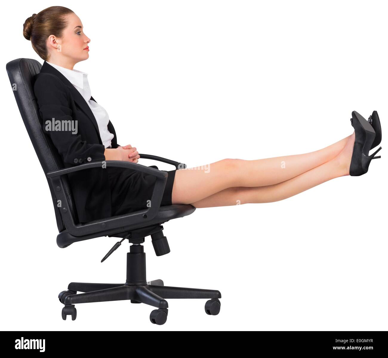swivel chair feet blu dot businesswoman sitting on with up stock photo