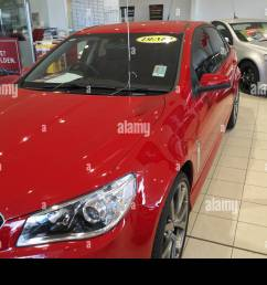 2014 red holden vf series commodore for sale in a holden dealership in sydney australia [ 1300 x 956 Pixel ]