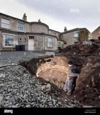 Builder inspects a hidden underground structure revealed ...
