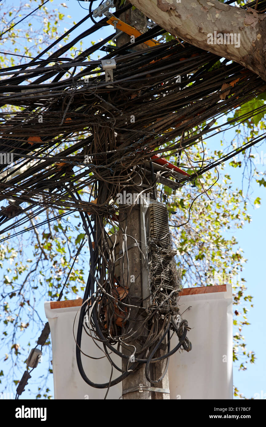 hight resolution of messy open telephone and electricity cables wires on pole in downtown santiago chile stock image