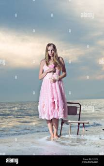 Beautiful Young Woman Standing Feet In Water Dressed