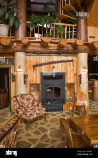 Fireplace in the living dining room area inside a rustic ...