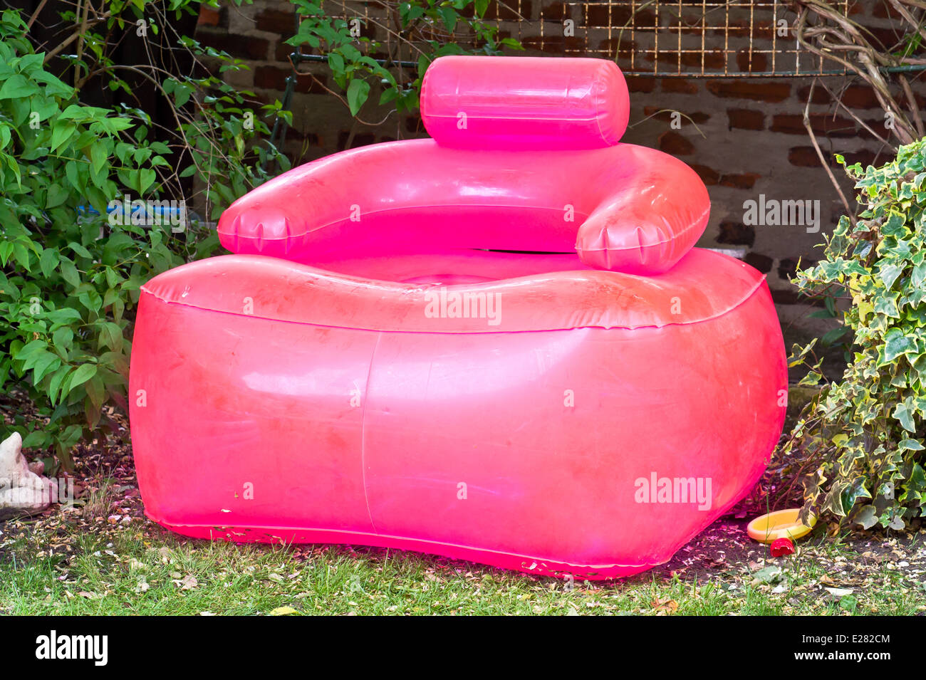 inflatable lawn chair wooden high nz a pink in garden stock photo royalty