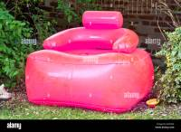 A pink inflatable chair in a garden Stock Photo, Royalty ...
