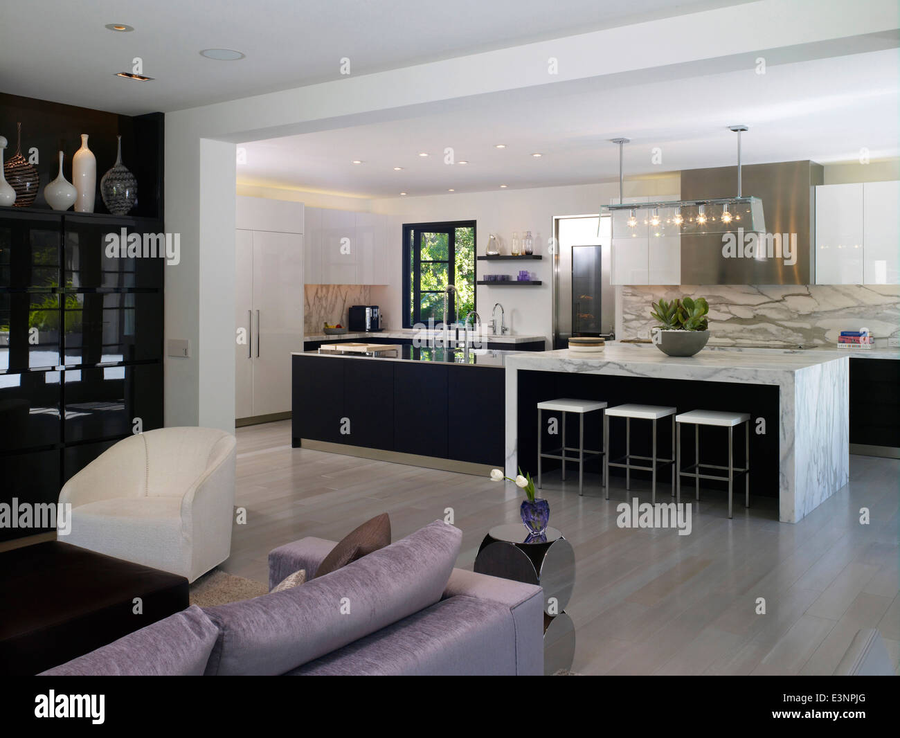 Open plan living room and kitchen in Stone House Atherton