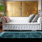 White Leather Chesterfield Sofa Below Gold Leaf Interior