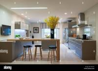 Modern Bulthaup kitchen with breakfast bar and stools