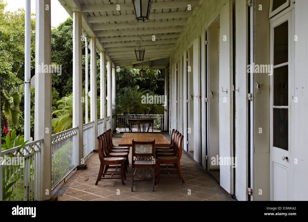Table And Chairs On Veranda Of La Maison Creole A French Colonial Stock Photo