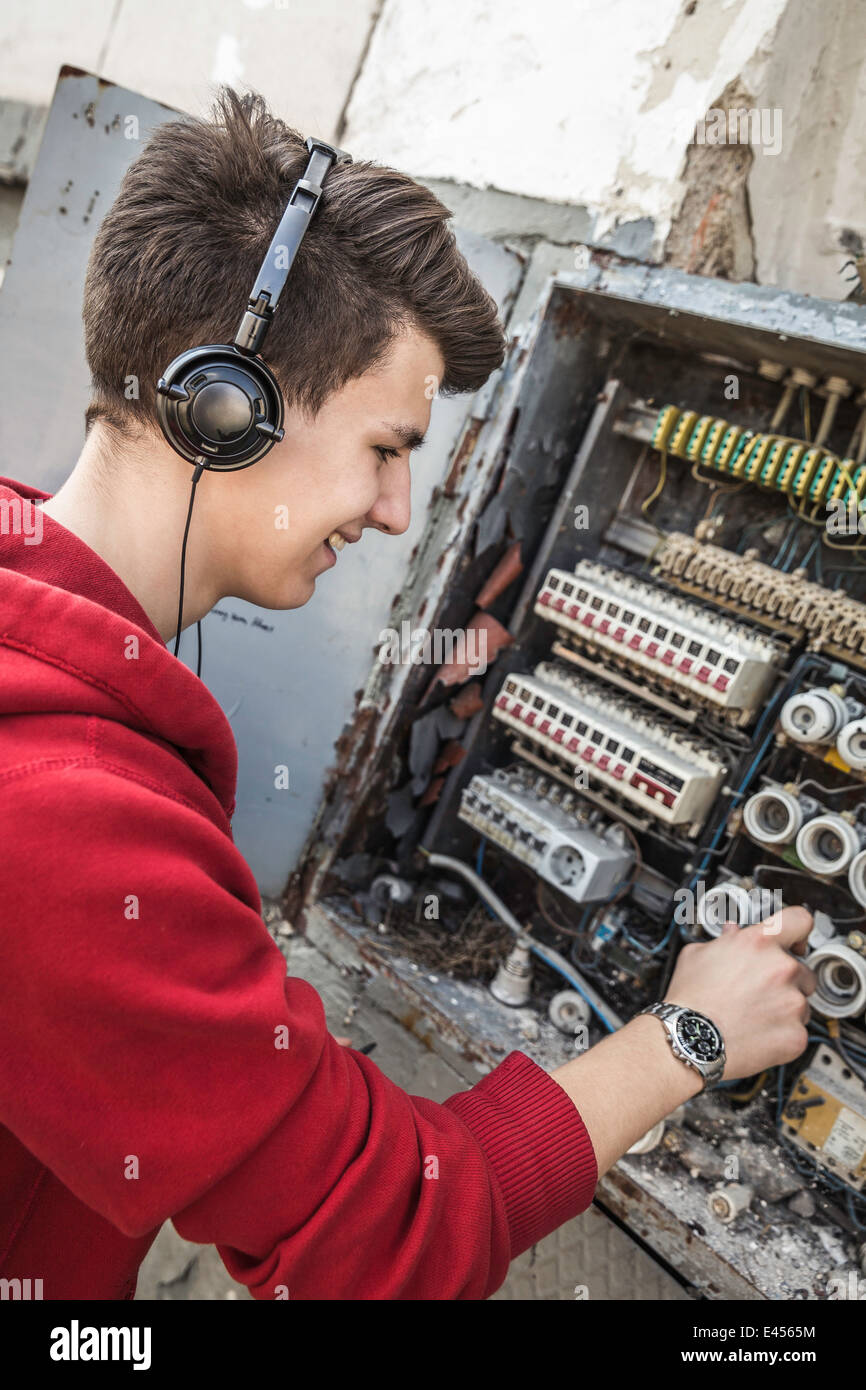 hight resolution of teenage boy using electrical fuse box like dj console