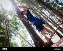 Boys Barefoot Climbing Ropes