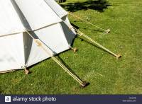 Traditional tent and wooden tent pegs Stock Photo ...