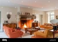 Large open fireplace in living room with Vico Magistretti ...