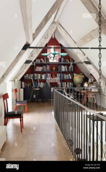 Mezzanine Level Library With Pitched Ceiling And Metal