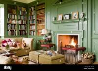 Fireplace with fender in cosy library painted in Calke ...
